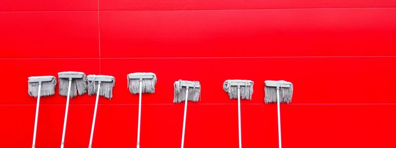 mops-cleaning-a wall